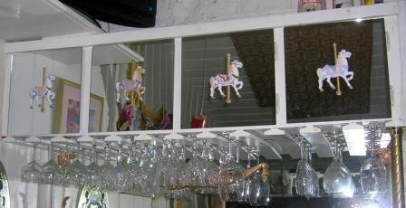 Custom-painted carousel horse ornaments.
